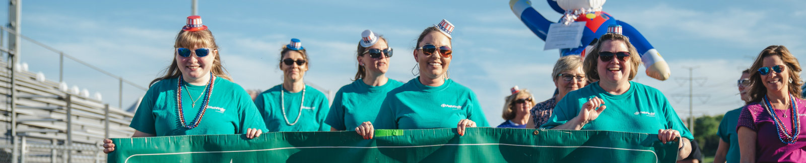 Group of Pathfinder Bank employees marching at Relay for Life Event 2019