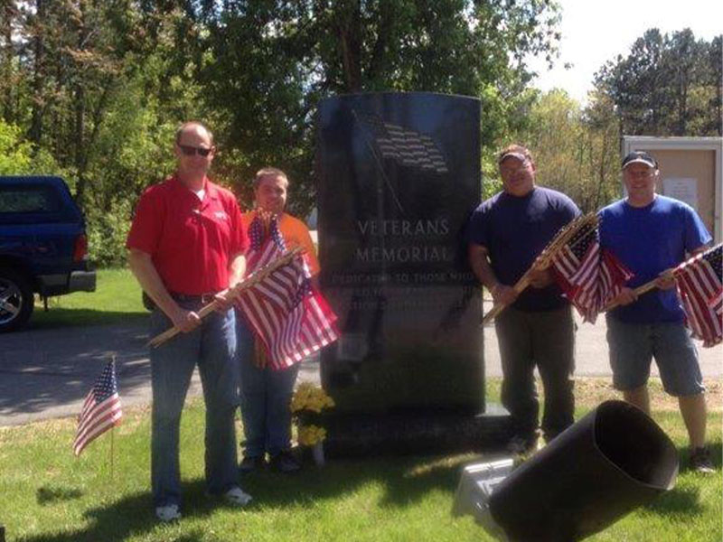 Putting flags up on Memorial Day: Volunteer work within our communities