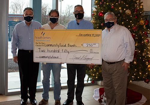 SJFCU donation to Chews United Methodist Church
