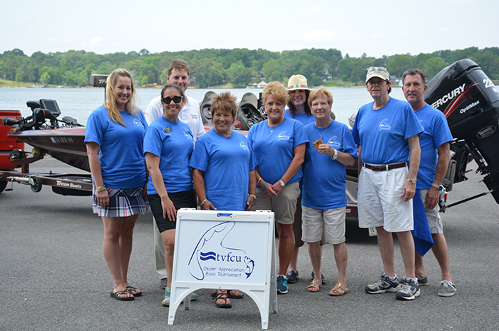 Employees smile after the inaugural Dealer Appreciation Bass Fishing Tournament.