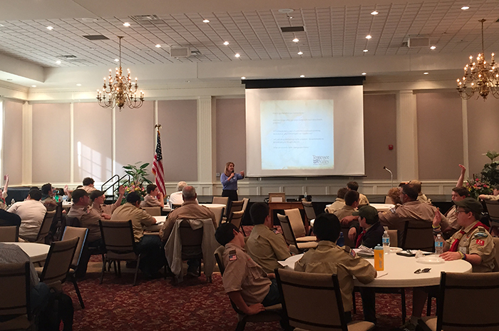 Tammy Zumbrun, community relations specialist, presents a financial literacy merit badge workshop to regional Boy Scouts.