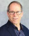 John Zmolek, CEO