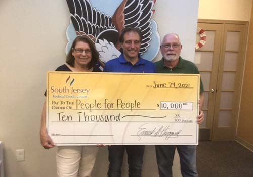 SJFCU presents $10,000 grant to People for People
