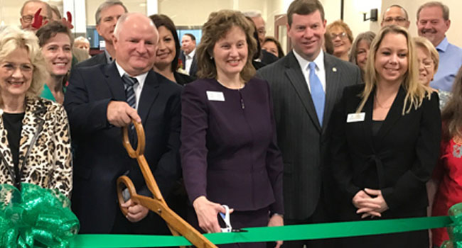 Thanks to the Wakulla County Chamber of Commerce for helping us welcome friends to our newly-completed building and home of Prime Meridian Bank Crawfordville. Bank CEO Sammie D. Dixon, Jr. (right) was on hand to join Wakulla Market President Lew Moore (left with scissors), Prime Meridian Bank Executive Vice President Susan Payne Turner, and Branch Manager Michelle Lawhon (far right) as they cut the green ribbon.